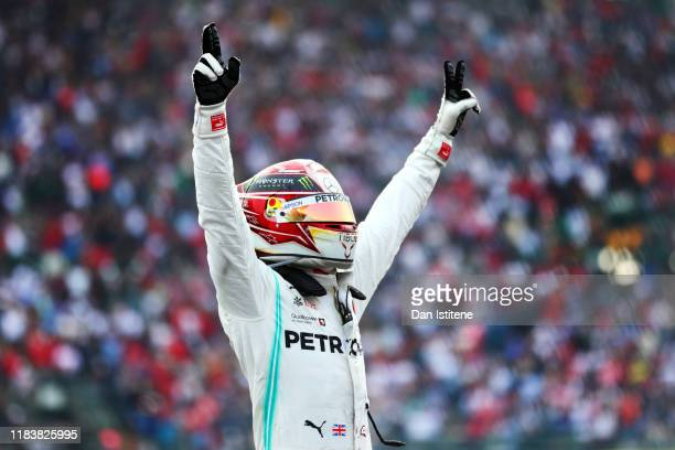 Race winner Lewis Hamilton of Great Britain and Mercedes GP celebrates in parc ferme during the F1 Grand Prix of Mexico at Autodromo Hermanos...