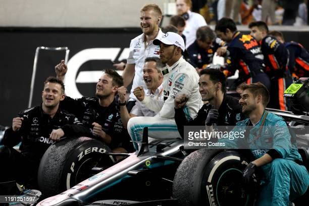 Race winner Lewis Hamilton of Great Britain and Mercedes GP celebrates in parc ferme during the F1 Grand Prix of Abu Dhabi at Yas Marina Circuit on...