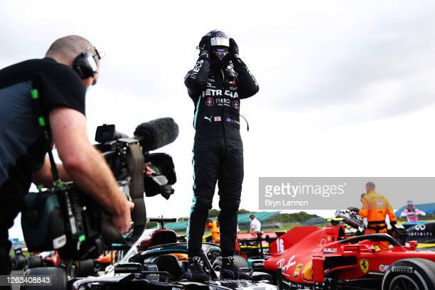 Race winner Lewis Hamilton of Great Britain and Mercedes GP celebrates in parc ferme during the F1 Grand Prix of Great Britain at Silverstone on...