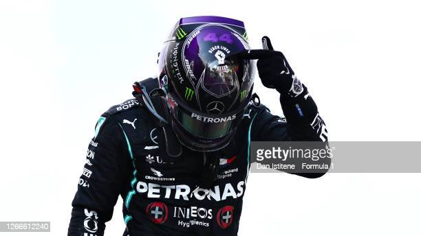 Race winner Lewis Hamilton of Great Britain and Mercedes GP celebrates in parc ferme during the F1 Grand Prix of Spain at Circuit de...