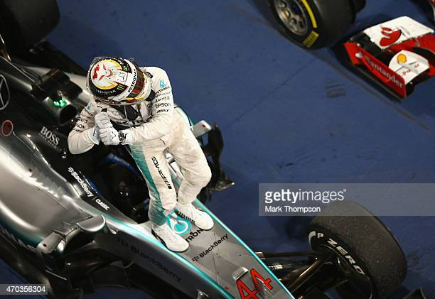 Race winner Lewis Hamilton of Great Britain and Mercedes GP celebrates in Parc Ferme following the Bahrain Formula One Grand Prix at Bahrain...