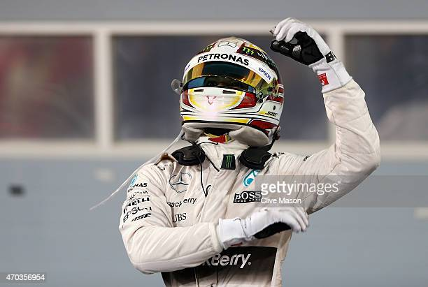 Race winner Lewis Hamilton of Great Britain and Mercedes GP celebrates celebrates in Parc Ferme following the Bahrain Formula One Grand Prix at...