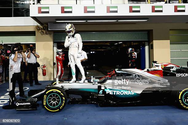 Race winner Lewis Hamilton of Great Britain and Mercedes GP in parc ferme during the Abu Dhabi Formula One Grand Prix at Yas Marina Circuit on...