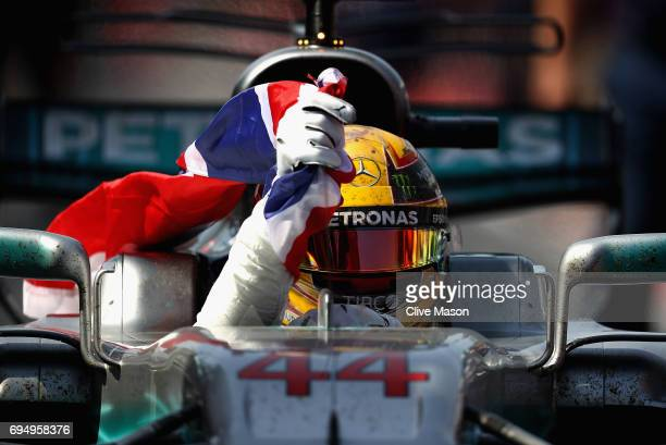 Race winner Lewis Hamilton of Great Britain and Mercedes GP celebrates in parc ferme during the Canadian Formula One Grand Prix at Circuit Gilles...
