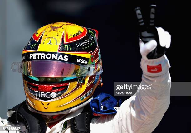 Race winner Lewis Hamilton of Great Britain and Mercedes GP celebrates in parc ferme during the Formula One Grand Prix of Italy at Autodromo di Monza...