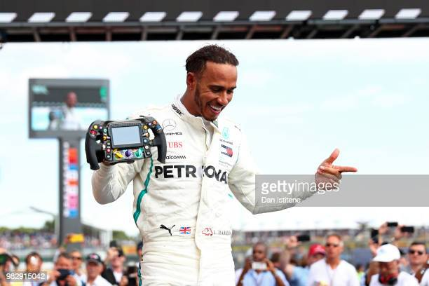 Race winner Lewis Hamilton of Great Britain and Mercedes GP celebrates in parc ferme during the Formula One Grand Prix of France at Circuit Paul...