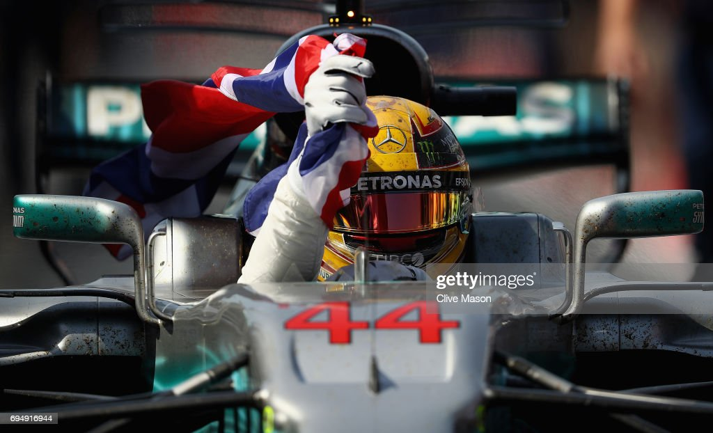 Race winner Lewis Hamilton of Great Britain and Mercedes GP celebrates in the Pitlane during the Canadian Formula One Grand Prix at Circuit Gilles Villeneuve on June 11, 2017 in Montreal, Canada.