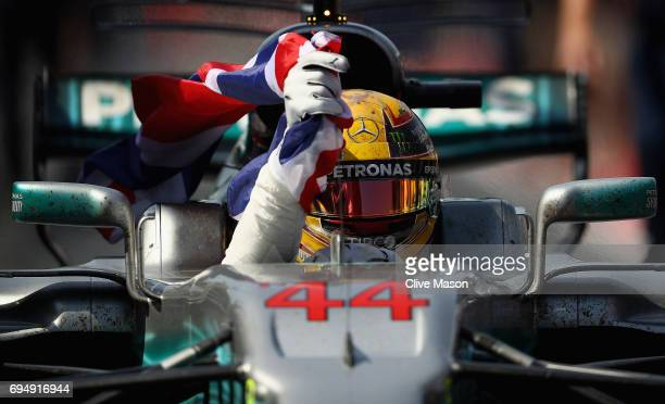 Race winner Lewis Hamilton of Great Britain and Mercedes GP celebrates in the Pitlane during the Canadian Formula One Grand Prix at Circuit Gilles...