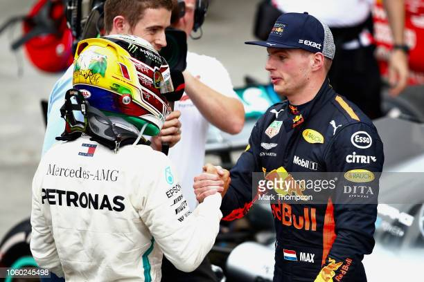 Race winner Lewis Hamilton of Great Britain and Mercedes GP is congratulated by second placed Max Verstappen of Netherlands and Red Bull Racing in...