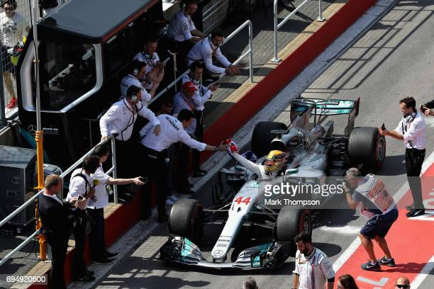 Race winner Lewis Hamilton of Great Britain and Mercedes GP is congratulated by Mercedes GP Executive Director Toto Wolff in the Pitlane during the...