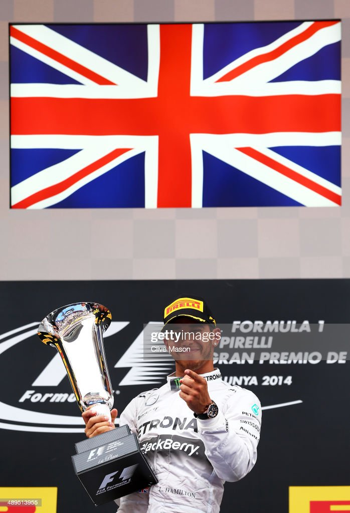 Race winner Lewis Hamilton of Great Britain and Mercedes GP lifts the trophy on the podium during the Spanish Formula One Grand Prix at Circuit de Catalunya on May 11, 2014 in Montmelo, Spain.