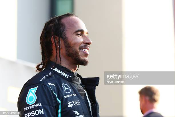 Race winner Lewis Hamilton of Great Britain and Mercedes GP looks on in parc ferme during the F1 Grand Prix of Tuscany at Mugello Circuit on...