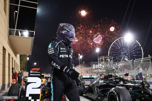 Race winner Lewis Hamilton of Great Britain and Mercedes GP looks on in parc ferme during the F1 Grand Prix of Bahrain at Bahrain International...