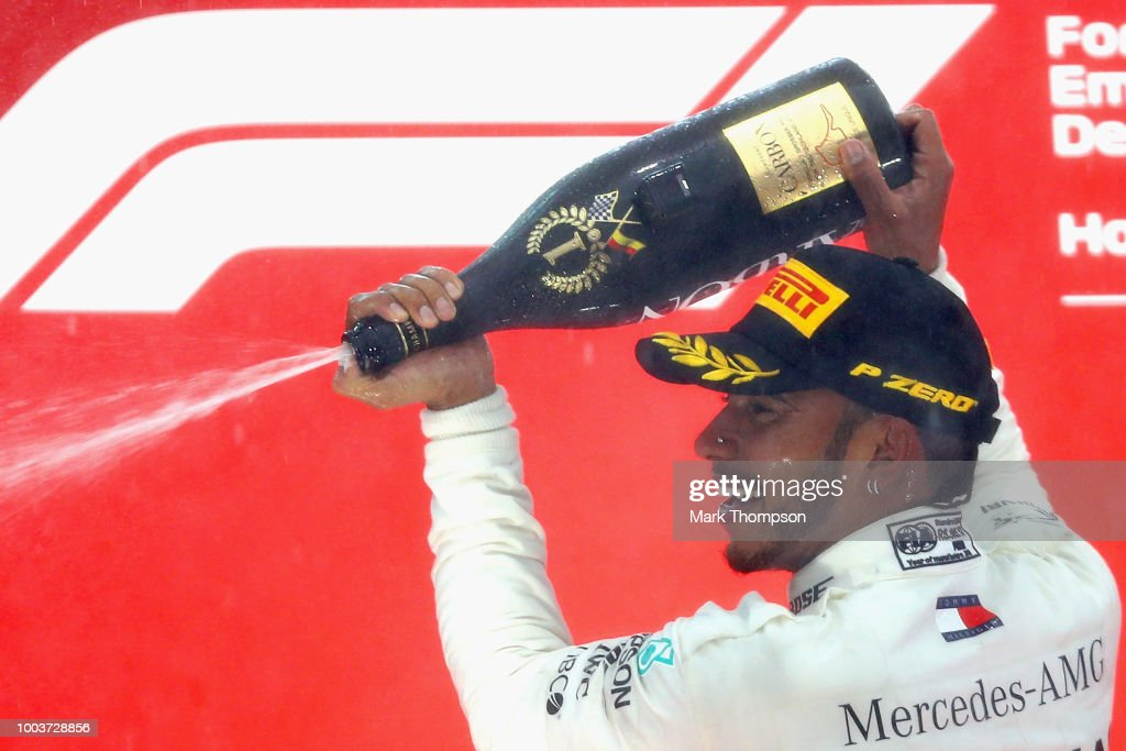 Race winner Lewis Hamilton of Great Britain and Mercedes GP celebrates on the podium during the Formula One Grand Prix of Germany at Hockenheimring on July 22, 2018 in Hockenheim, Germany.