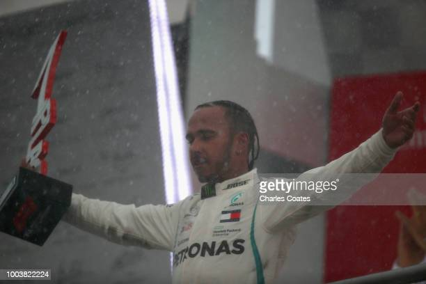 Race winner Lewis Hamilton of Great Britain and Mercedes GP celebrates on the podium during the Formula One Grand Prix of Germany at Hockenheimring...