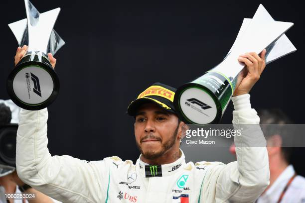 Race winner Lewis Hamilton of Great Britain and Mercedes GP celebrates on the podium during the Formula One Grand Prix of Brazil at Autodromo Jose...