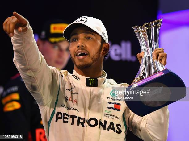 Race winner Lewis Hamilton of Great Britain and Mercedes GP celebrates on the podium during the Abu Dhabi Formula One Grand Prix at Yas Marina...
