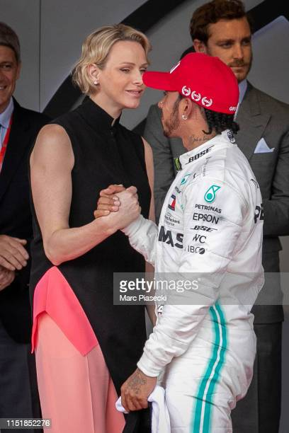 Race winner Lewis Hamilton of Great Britain and Mercedes GP celebrates on the podium during the F1 Grand Prix of Monaco at Circuit de Monaco on May...