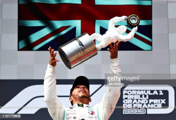 Race winner Lewis Hamilton of Great Britain and Mercedes GP celebrates on the podium during the F1 Grand Prix of France at Circuit Paul Ricard on...