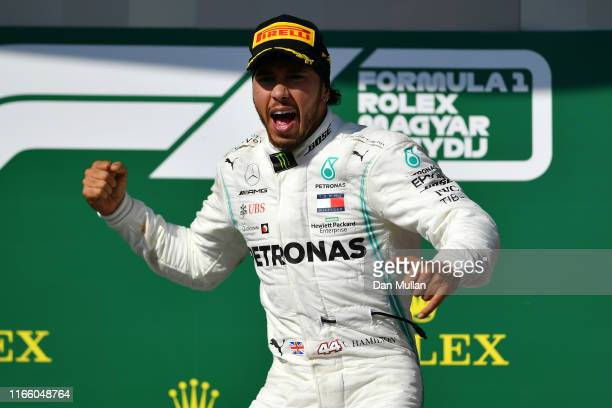 Race winner Lewis Hamilton of Great Britain and Mercedes GP celebrates on the podium during the F1 Grand Prix of Hungary at Hungaroring on August 04...