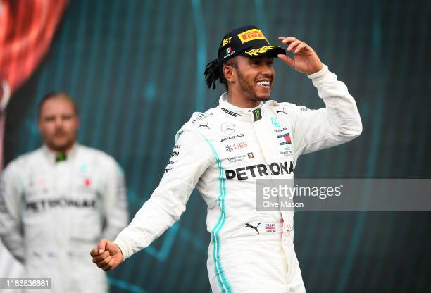 Race winner Lewis Hamilton of Great Britain and Mercedes GP celebrates on the podium during the F1 Grand Prix of Mexico at Autodromo Hermanos...