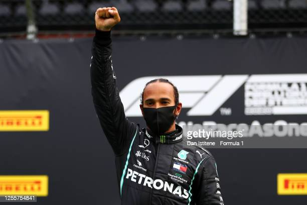 Race winner Lewis Hamilton of Great Britain and Mercedes GP celebrates on the podium during the Formula One Grand Prix of Styria at Red Bull Ring on...