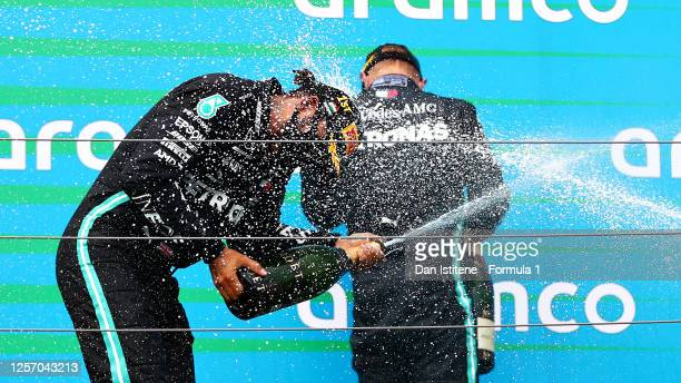 Race winner Lewis Hamilton of Great Britain and Mercedes GP celebrates on the podium during the Formula One Grand Prix of Hungary at Hungaroring on...