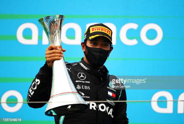 Race winner Lewis Hamilton of Great Britain and Mercedes GP celebrates on the podium after the Formula One Grand Prix of Hungary at Hungaroring on...