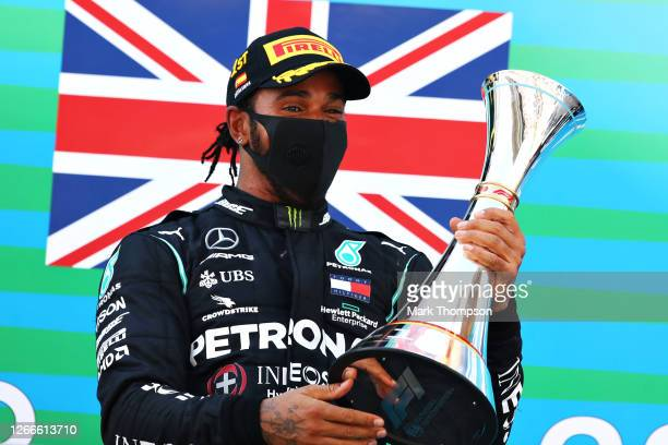 Race winner Lewis Hamilton of Great Britain and Mercedes GP celebrates on the podium during the F1 Grand Prix of Spain at Circuit de...