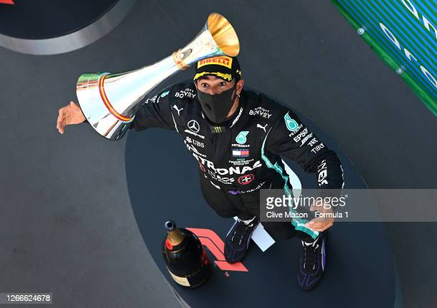 Race winner Lewis Hamilton of Great Britain and Mercedes GP celebrates on the podium by throwing his trophy in the air during the F1 Grand Prix of...