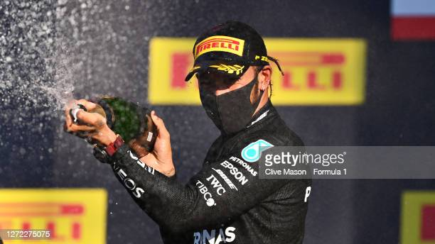 Race winner Lewis Hamilton of Great Britain and Mercedes GP celebrates on the podium during the F1 Grand Prix of Tuscany at Mugello Circuit on...