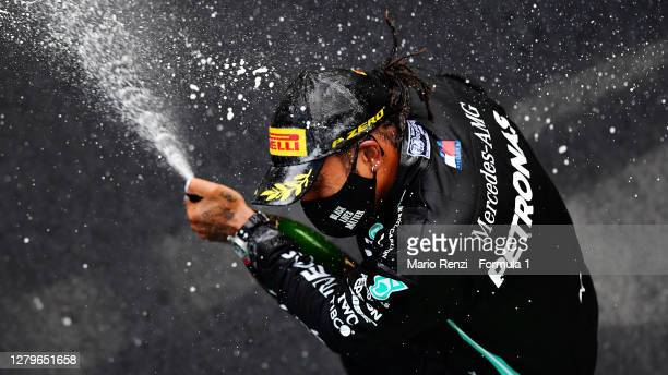 Race winner Lewis Hamilton of Great Britain and Mercedes GP celebrates on the podium during the F1 Eifel Grand Prix at Nuerburgring on October 11,...