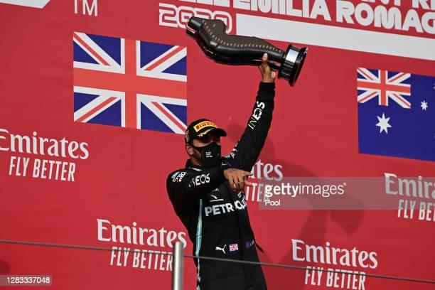 Race winner Lewis Hamilton of Great Britain and Mercedes GP celebrates on the podium during the F1 Grand Prix of Emilia Romagna at Autodromo Enzo e...