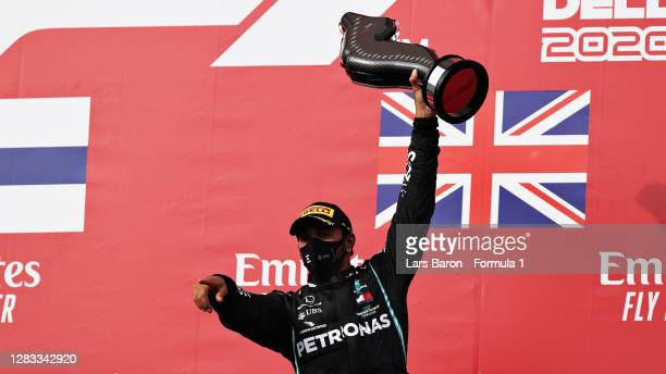 Race winner Lewis Hamilton of Great Britain and Mercedes GP celebrates on the podium during the F1 Grand Prix of Emilia Romagna at Autodromo Enzo e...