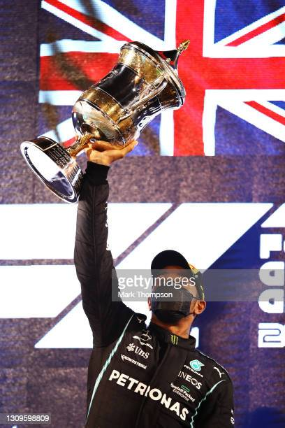 Race winner Lewis Hamilton of Great Britain and Mercedes GP celebrates on the podium during the F1 Grand Prix of Bahrain at Bahrain International...