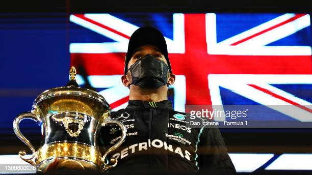 Race winner Lewis Hamilton of Great Britain and Mercedes GP celebrates on the podium after during the F1 Grand Prix of Bahrain at Bahrain...