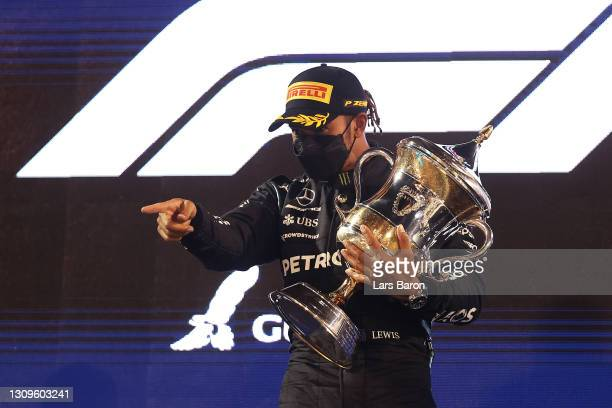 Race winner Lewis Hamilton of Great Britain and Mercedes GP celebrates on the podium after the F1 Grand Prix of Bahrain at Bahrain International...