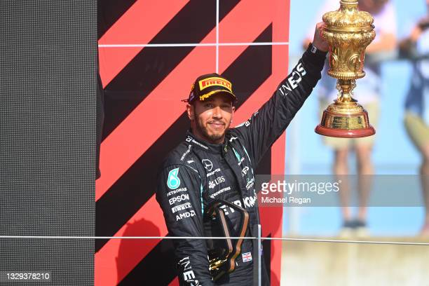 Race winner Lewis Hamilton of Great Britain and Mercedes GP celebrates on the podium during the F1 Grand Prix of Great Britain at Silverstone on July...
