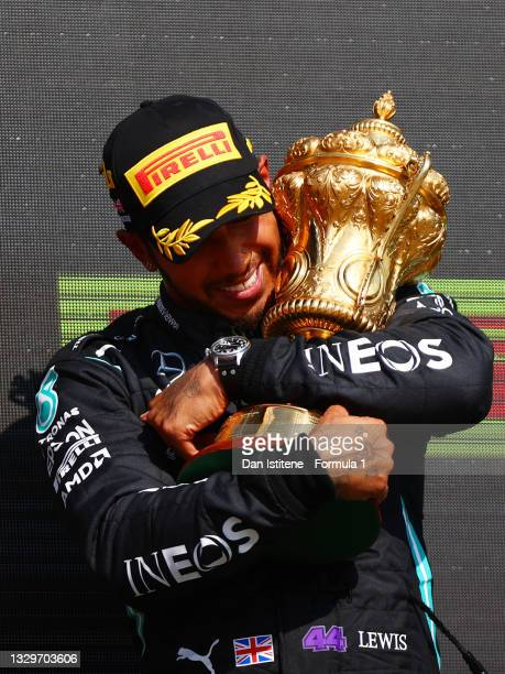 Race winner Lewis Hamilton of Great Britain and Mercedes GP celebrates on the podium after the F1 Grand Prix of Great Britain at Silverstone on July...