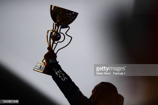 Race winner Lewis Hamilton of Great Britain and Mercedes GP celebrates on the podium during the F1 Grand Prix of Russia at Sochi Autodrom on...