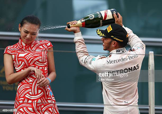 Race winner Lewis Hamilton of Great Britain and Mercedes GP celebrates on the podium during the Formula One Grand Prix of China at Shanghai...