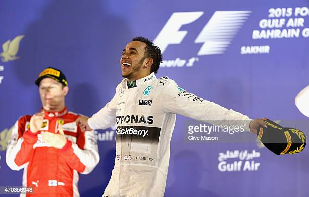 Race winner Lewis Hamilton of Great Britain and Mercedes GP celebrates on the podium during the Bahrain Formula One Grand Prix at Bahrain...