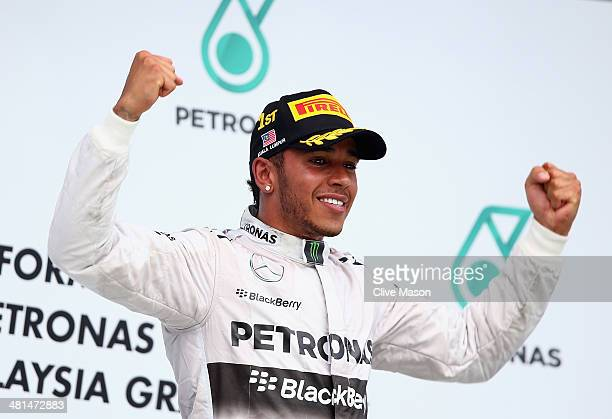 Race winner Lewis Hamilton of Great Britain and Mercedes GP celebrates on the podium after the Malaysia Formula One Grand Prix at the Sepang Circuit...