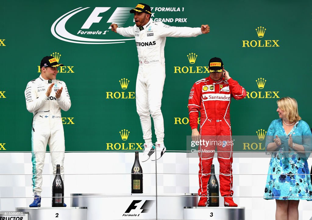 Race winner Lewis Hamilton of Great Britain and Mercedes GP celebrates on the podium with second placed Valtteri Bottas of Finland and Mercedes GP and third placed Kimi Raikkonen of Finland and Ferrari during the Formula One Grand Prix of Great Britain at Silverstone on July 16, 2017 in Northampton, England.