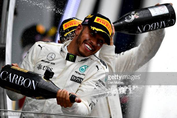 Race winner Lewis Hamilton of Great Britain and Mercedes GP celebrates on the podium during the Formula One Grand Prix of Great Britain at...