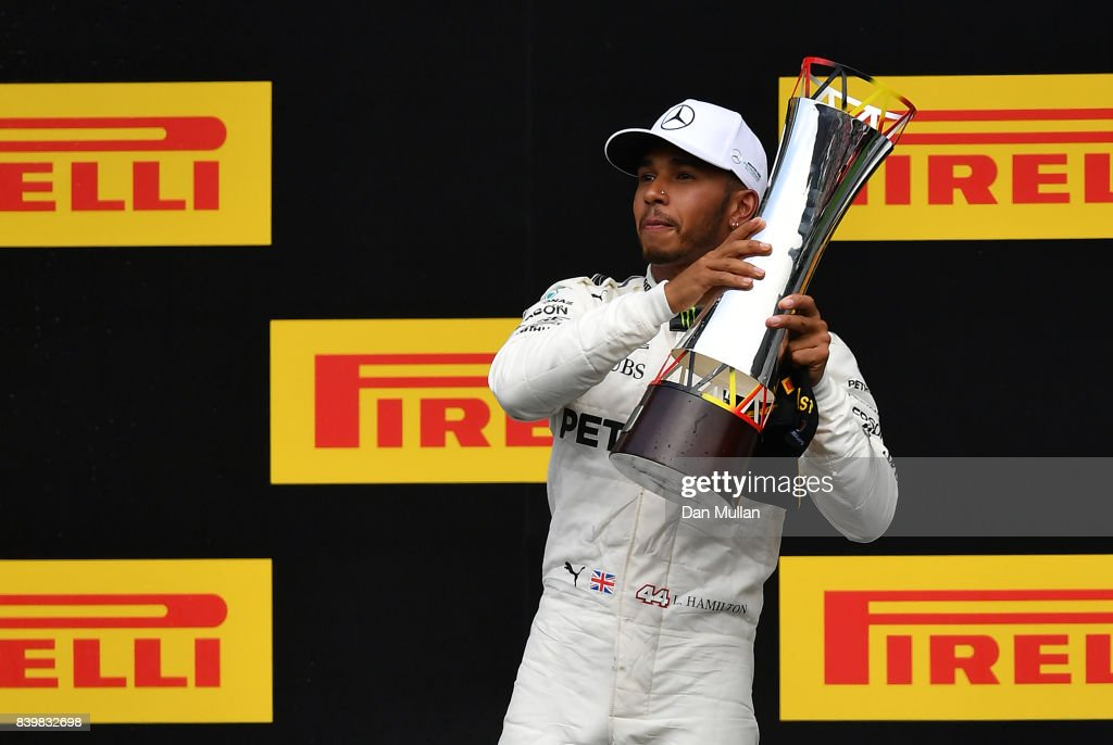 Race winner Lewis Hamilton of Great Britain and Mercedes GP celebrates on the podium during the Formula One Grand Prix of Belgium at Circuit de Spa-Francorchamps on August 27, 2017 in Spa, Belgium.