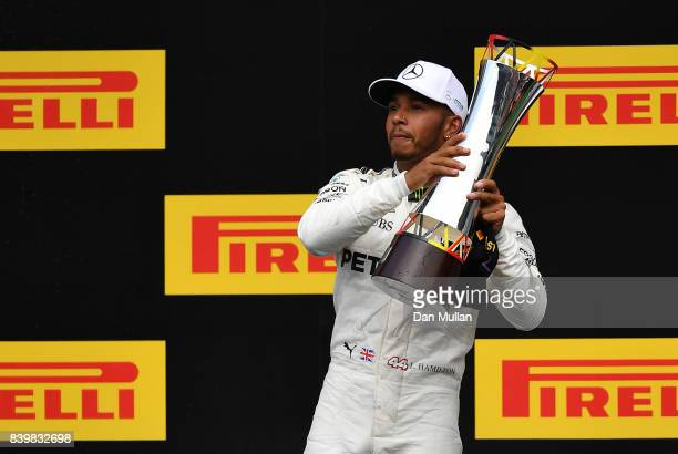 Race winner Lewis Hamilton of Great Britain and Mercedes GP celebrates on the podium during the Formula One Grand Prix of Belgium at Circuit de...