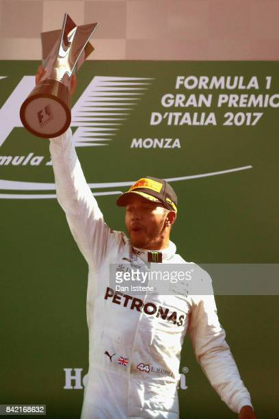 Race winner Lewis Hamilton of Great Britain and Mercedes GP celebrates on the podium during the Formula One Grand Prix of Italy at Autodromo di Monza...