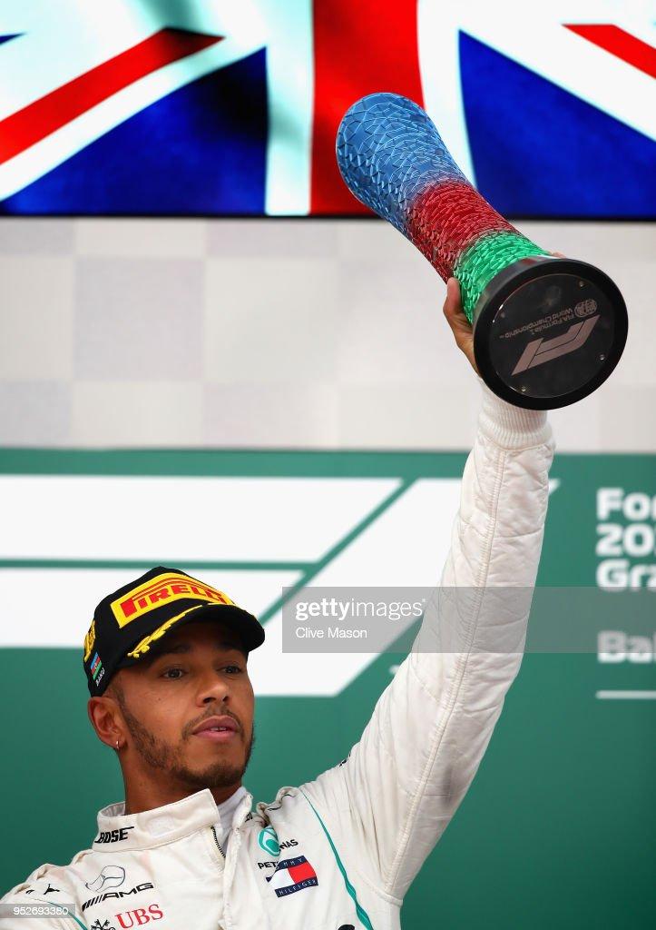 Race winner Lewis Hamilton of Great Britain and Mercedes GP celebrates on the podium during the Azerbaijan Formula One Grand Prix at Baku City Circuit on April 29, 2018 in Baku, Azerbaijan.