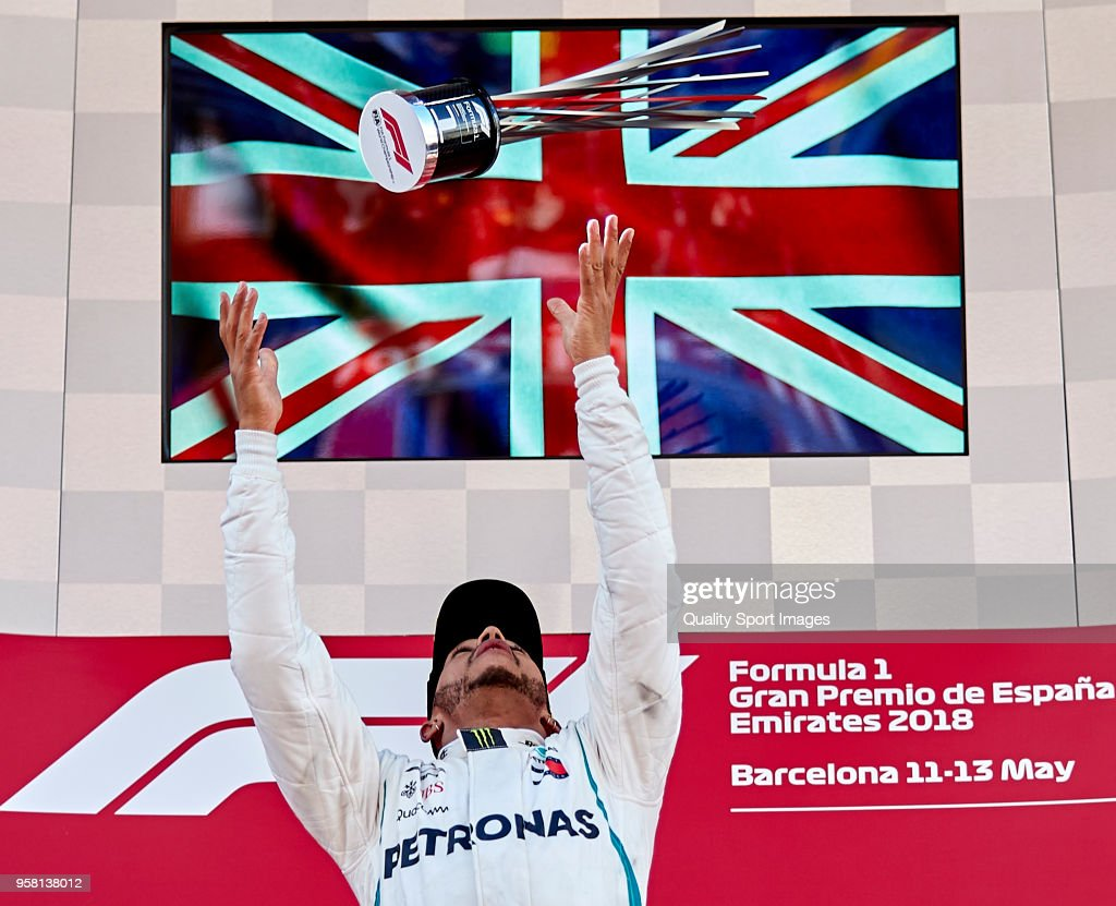 Race winner Lewis Hamilton of Great Britain and Mercedes GP celebrates on the podium during the Spanish Formula One Grand Prix at Circuit de Catalunya on May 13, 2018 in Montmelo, Spain.